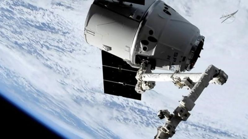 Canadian astronaut Saint-Jacques pulls in SpaceX shipment to space station
