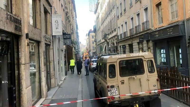 French police hunt bomber after blast injures 13