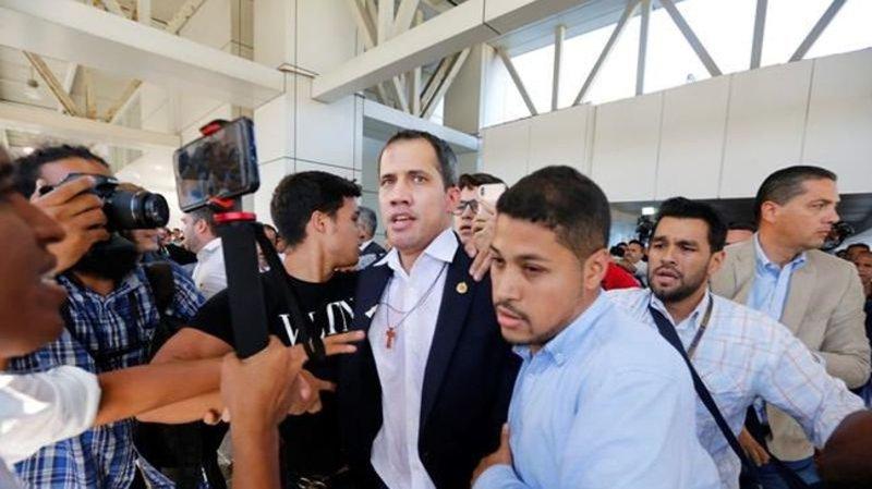 Opposition leader Guaido returns to Venezuela after tour
