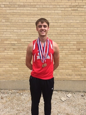 Vandals Curtis Gordon is Class 1A State Champ in Pole Vault