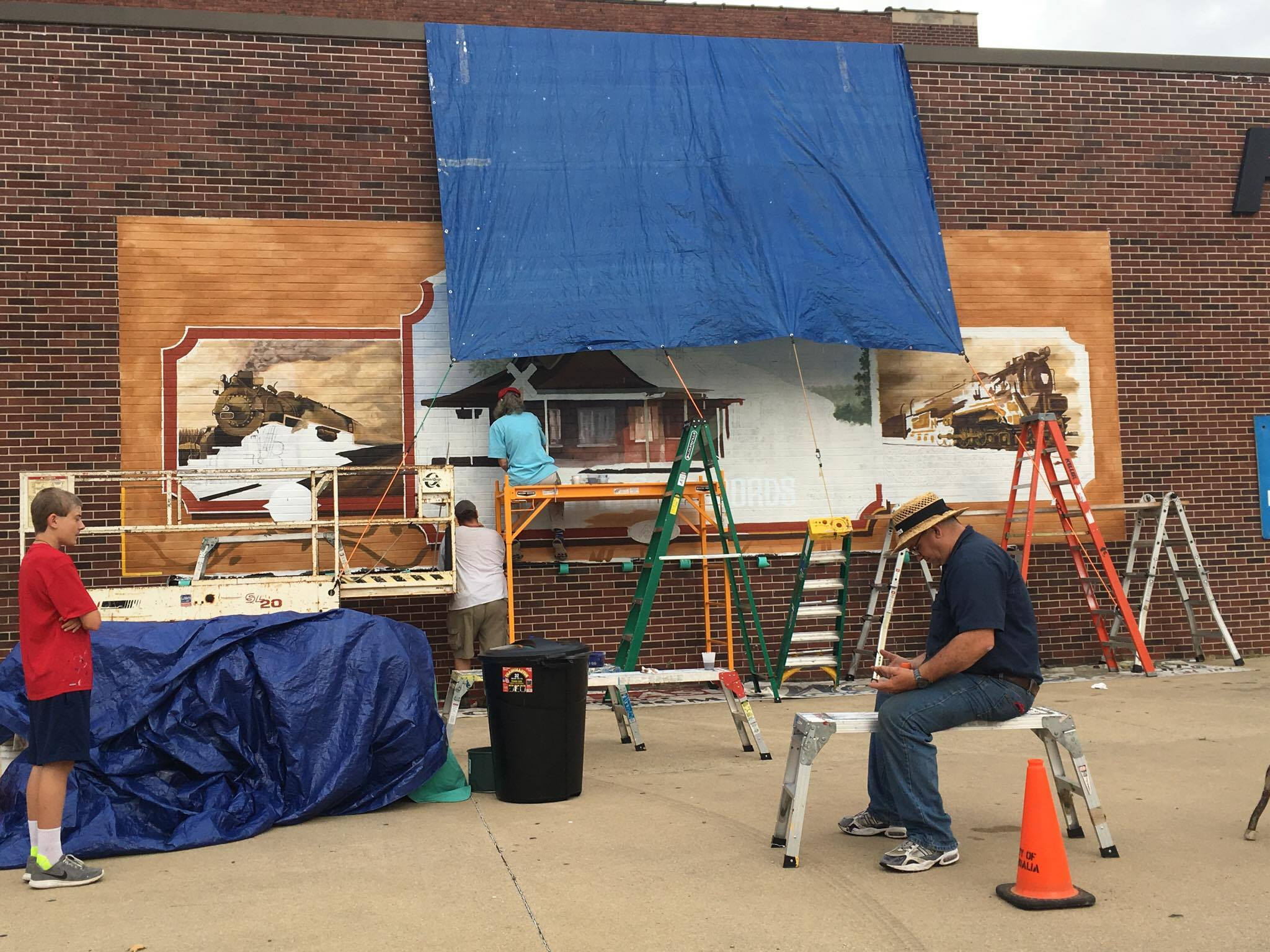 """Downtown Mural work continues with """"Little Toot"""" giving rides to Children"""