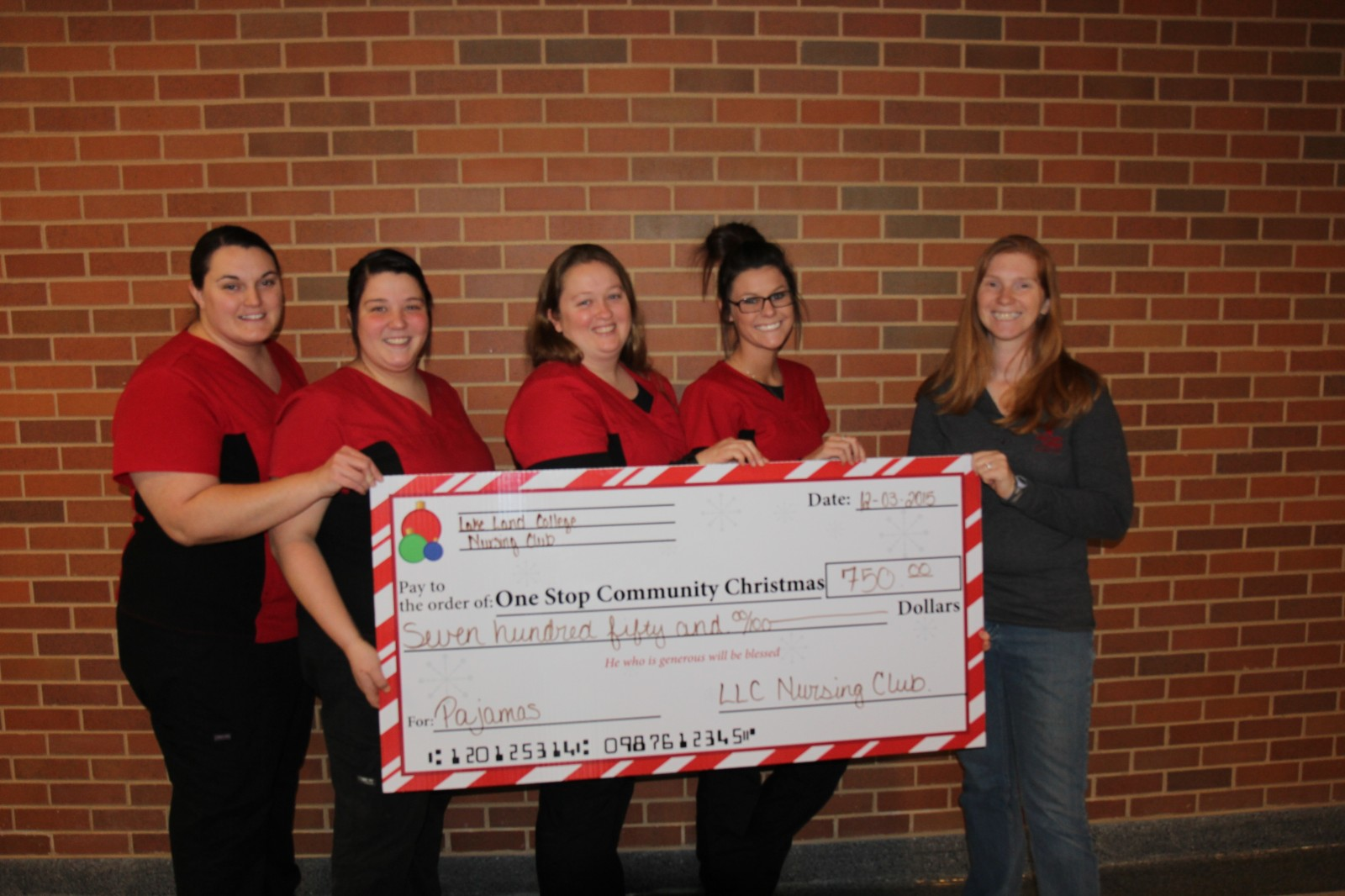 Lake Land College Nursing Club makes a donation to One Stop Community Christmas