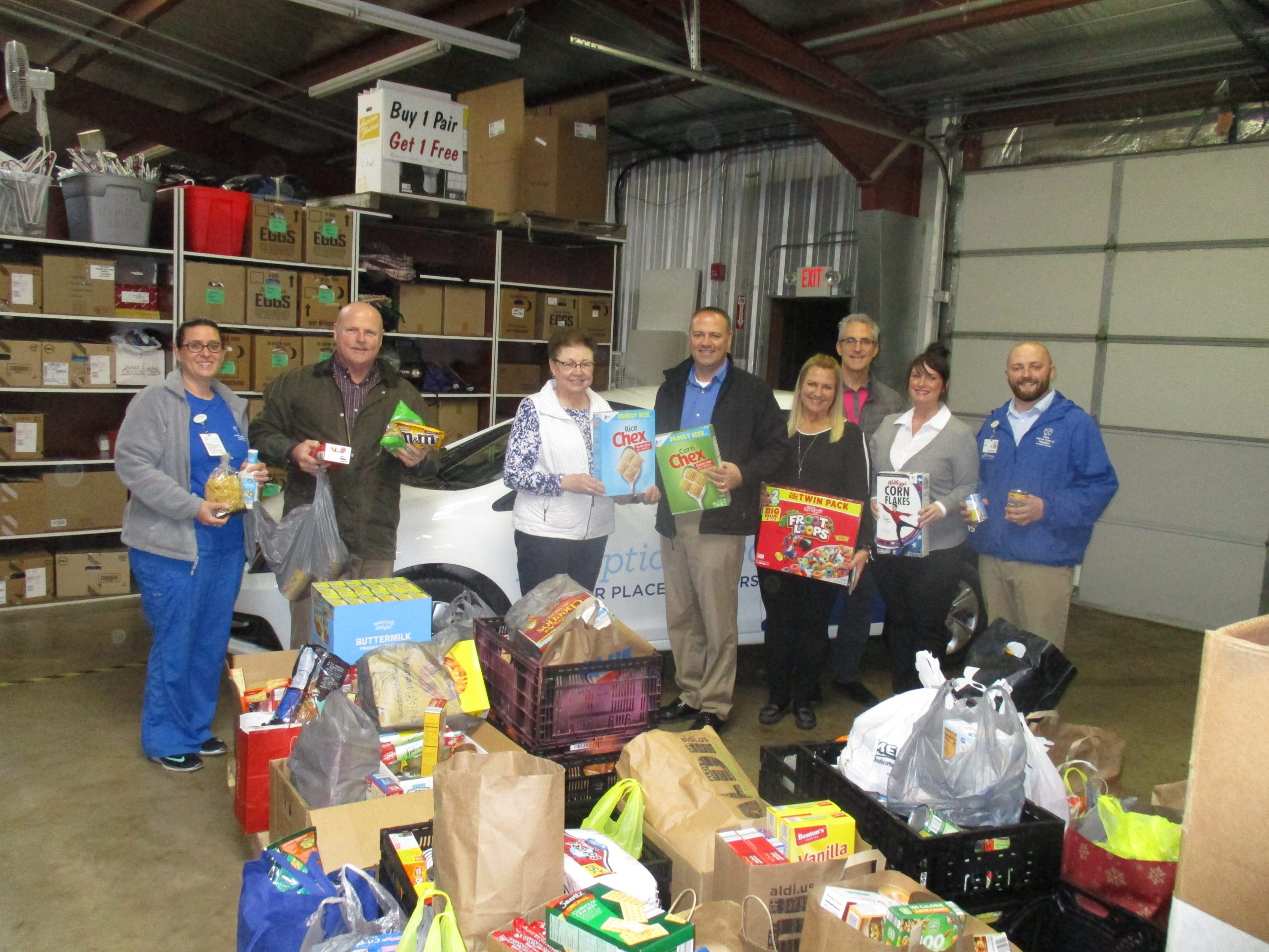 "HSHS Home Care and Hospice ""Crams the Car"" with Canned Goods for Catholic Charities"