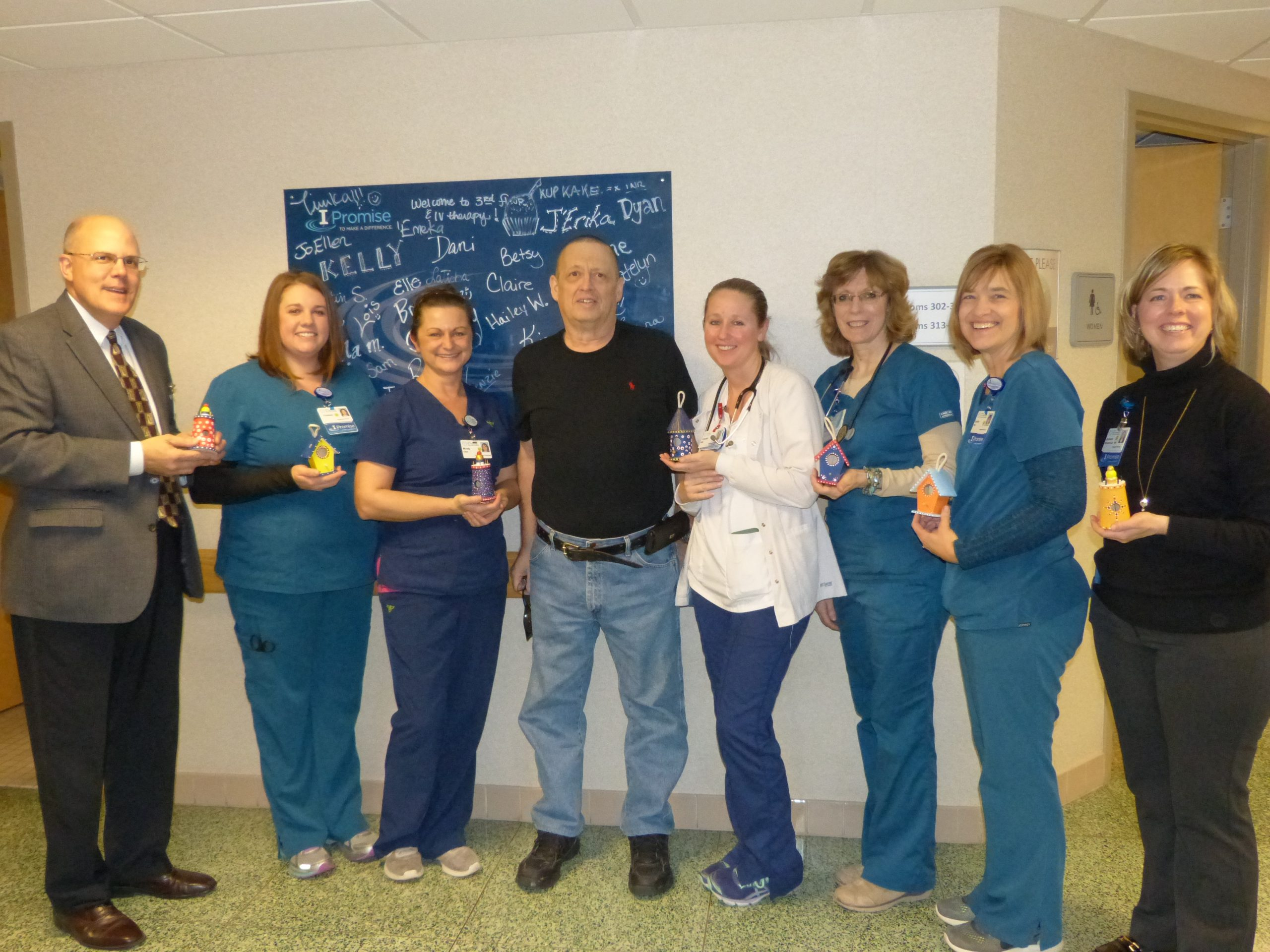 Grateful patient gives token of his appreciation to HSHS St. Anthony's Memorial Hospital nursing staff who cared for him