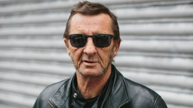 Former AC/DC Drummer Has Heart Attack, Leaves Hospital For A Smoke, Returns in A Ferrari