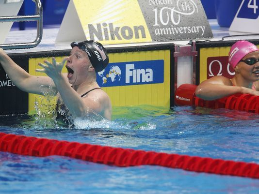 EVANSVILLE NATIVE & OLYMPIC GOLD MEDALIST LILLY KING SETS WORLD RECORD