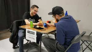 Gamers play board games at VRKADE in NE Calgary for Game Day with the Extra Life Calgary Guild