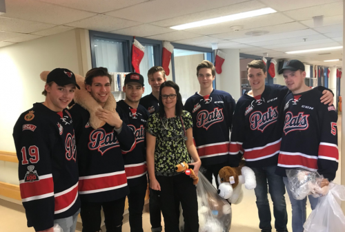 Regina Pats spend Tuesday distributing teddy bears