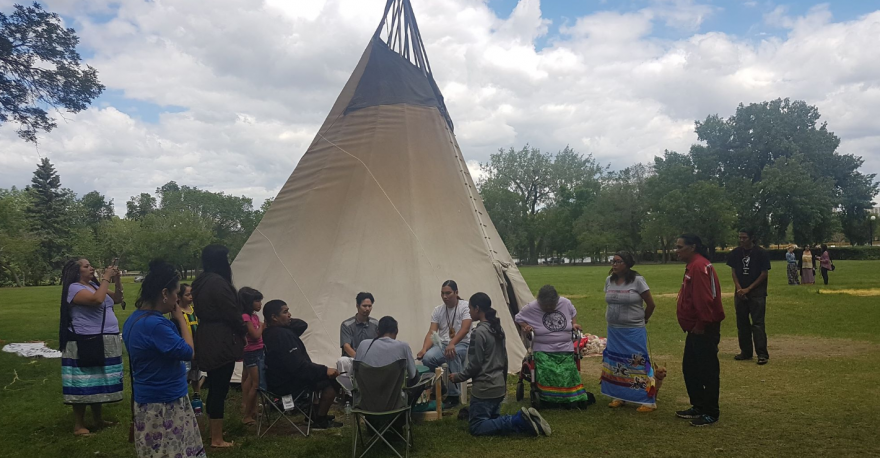 Tipi back up in front of Saskatchewan Legislature