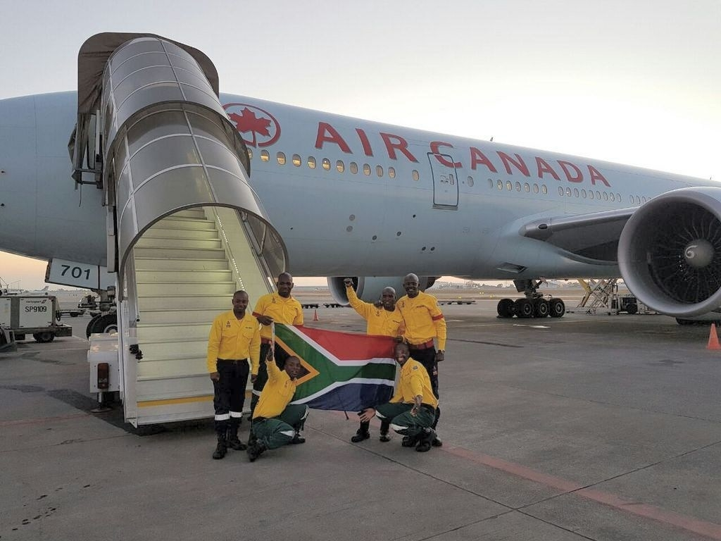 300 South African firefighters arrive in Canada to battle Alberta wildfires