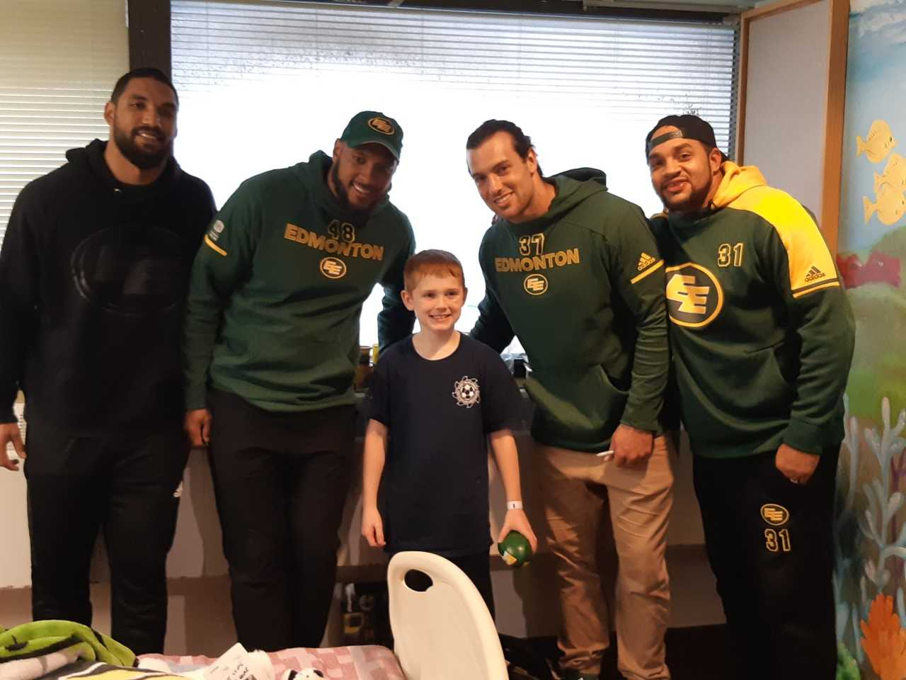 Eskimos Players Visit Patients At NLRHC