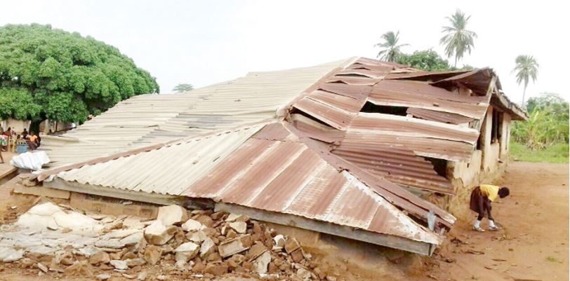 Rainstorm destroys school and compels pupils to study under tree