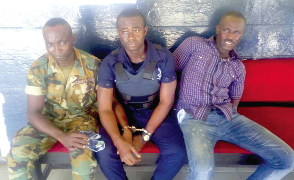 Soldier, police officer, one other arrested for allegedly robbing bank customers