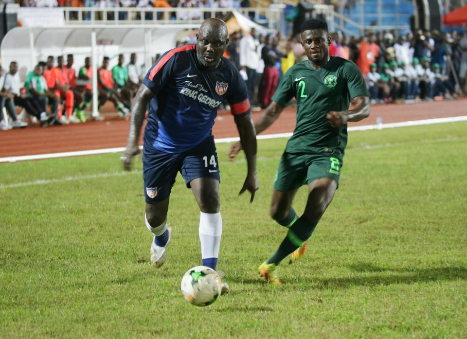 George Weah plays for Liberia at 51 on same night President's son features for USA