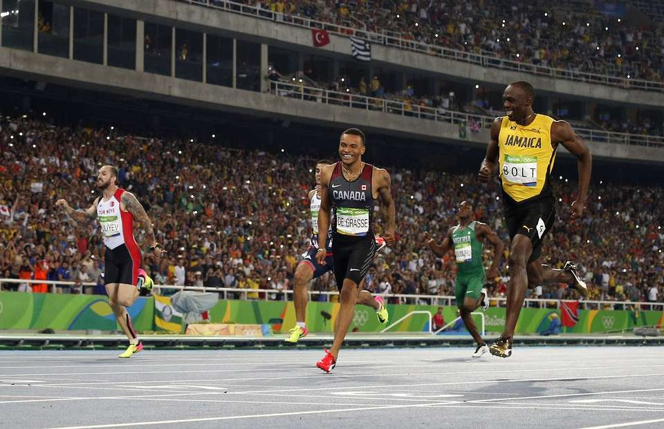 Usain Bolt shares a joke on the finish line as he reaches 200m final
