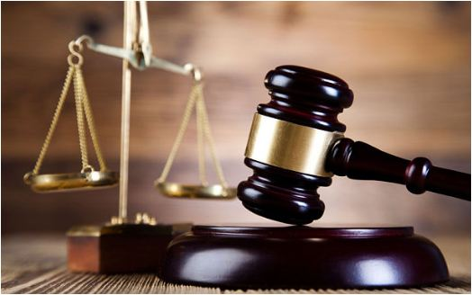 Two fined for fighting over woman on court premises