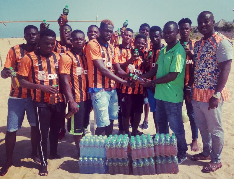 National beach soccer team coach Daniel Kotey presents Kasapreko drinks to Team Volta in Keta