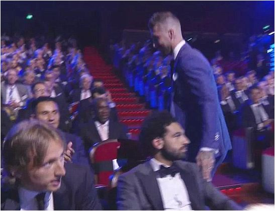 Sergio Ramos awkwardly touches Mohamed Salah on shoulder he injured in Champions League final