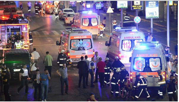 Istanbul Ataturk Airport terror attack: CCTV shows suicide bomber fire on crowds in massacre that left 41 dead