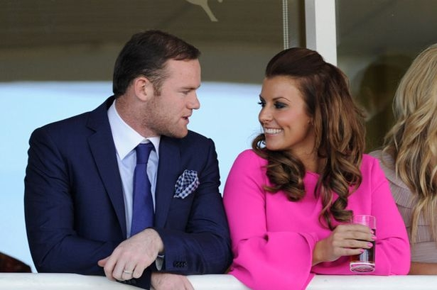Rooney's wife hits back at England boo-boys as he's axed for Slovenia clash
