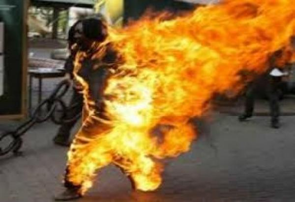Man sets girlfriend on fire after discovering love messages on her phone