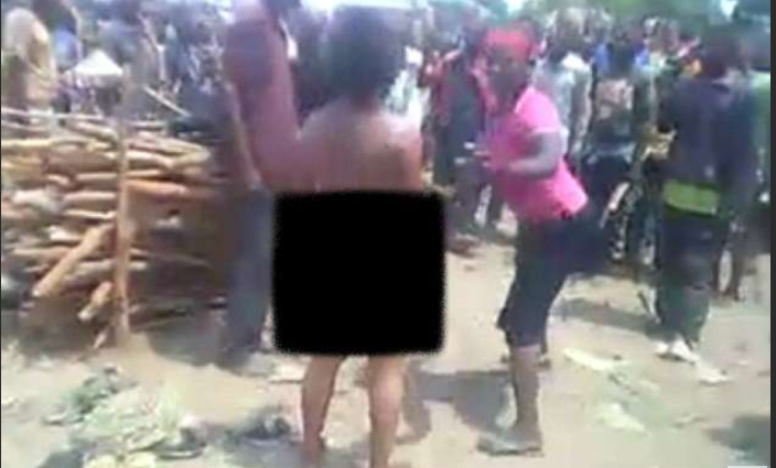 PHOTOS: Woman raped, whipped and beheaded in front of a cheering crowd