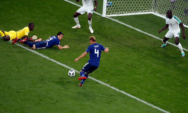Japan come from behind twice to draw 2-2 with Senegal in Group H clash