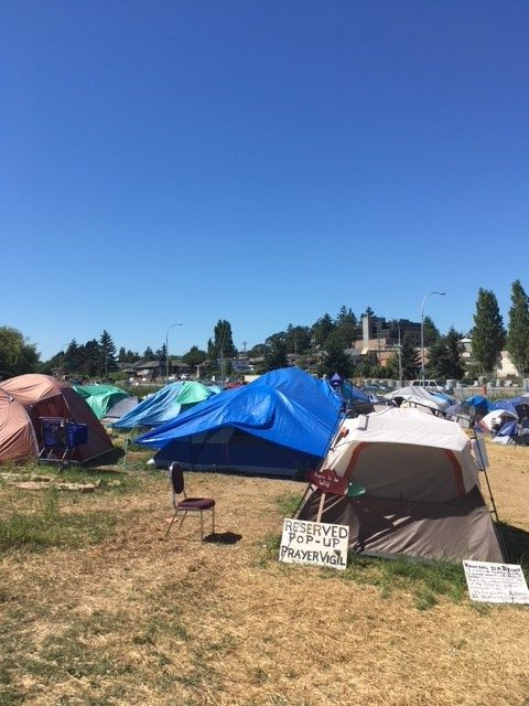 Fire department says fire at tent city started by cigarette