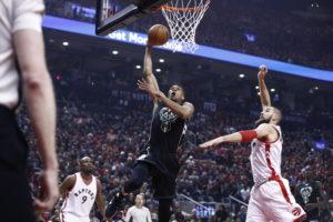 Bucks grab playoff series opener in Toronto