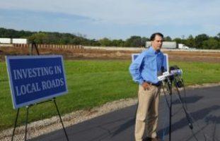 Walker warns of project delays if transportation split from budget