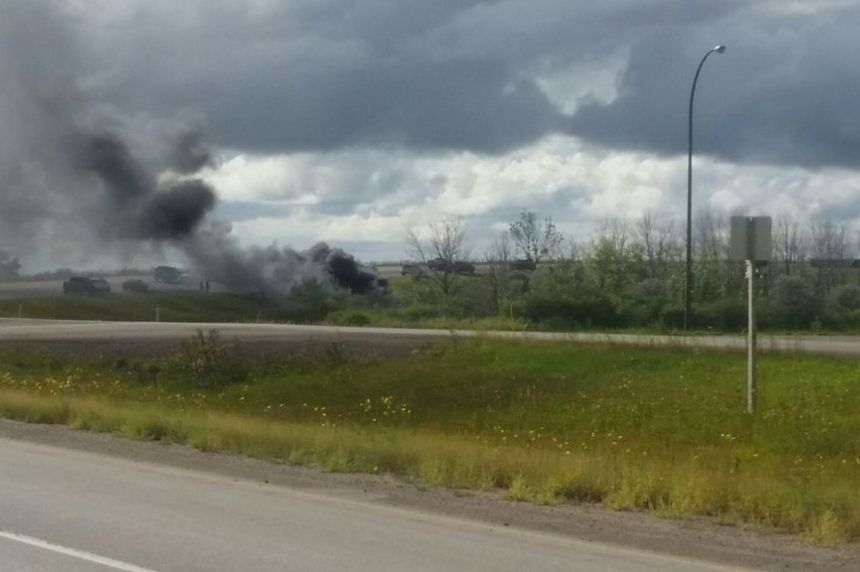 2 men taken to hospital after vehicle rolls, catches fire near Belle Plaine, Sask.