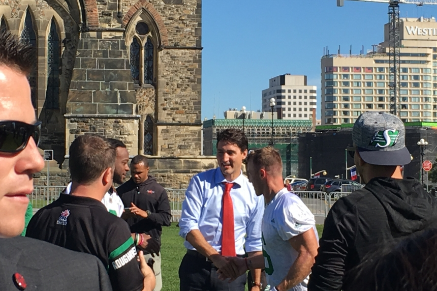 Roughriders practice on Parliament Hill with the Prime Minister