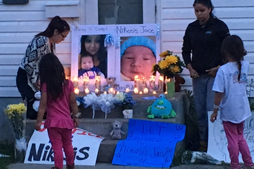 Family holds candlelight vigil in memory of murdered Saskatoon baby