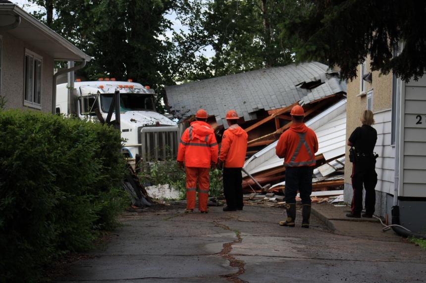 South Regina collision sends semi into garage near Ring Road