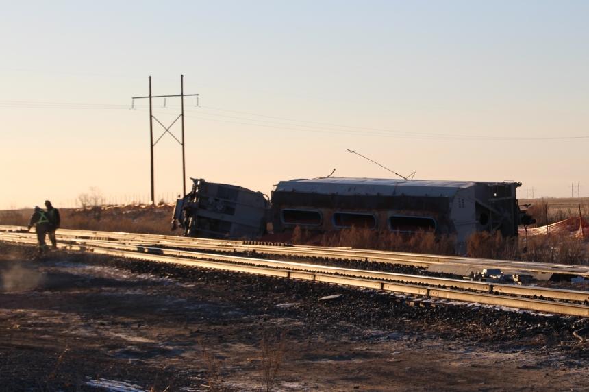 Train cars flipped sideways after derailment near Watrous