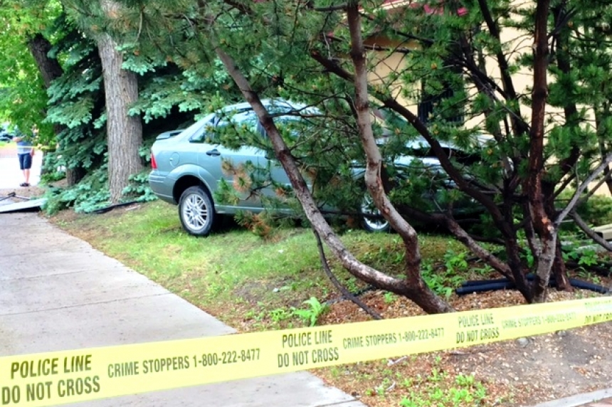 Driver injured as crash nearly sends car into building