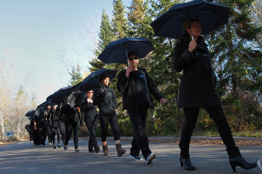 Black-clad marchers bring attention to human trafficking