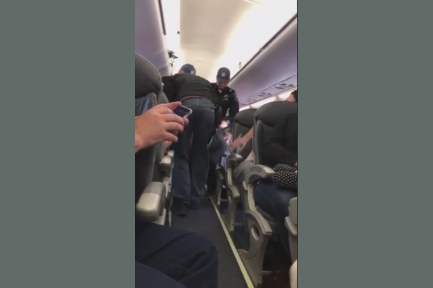 Video of passenger getting dragged off flight sparks uproar