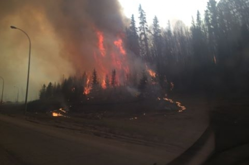 Fire burns in Fort McMurray as people flee their homes