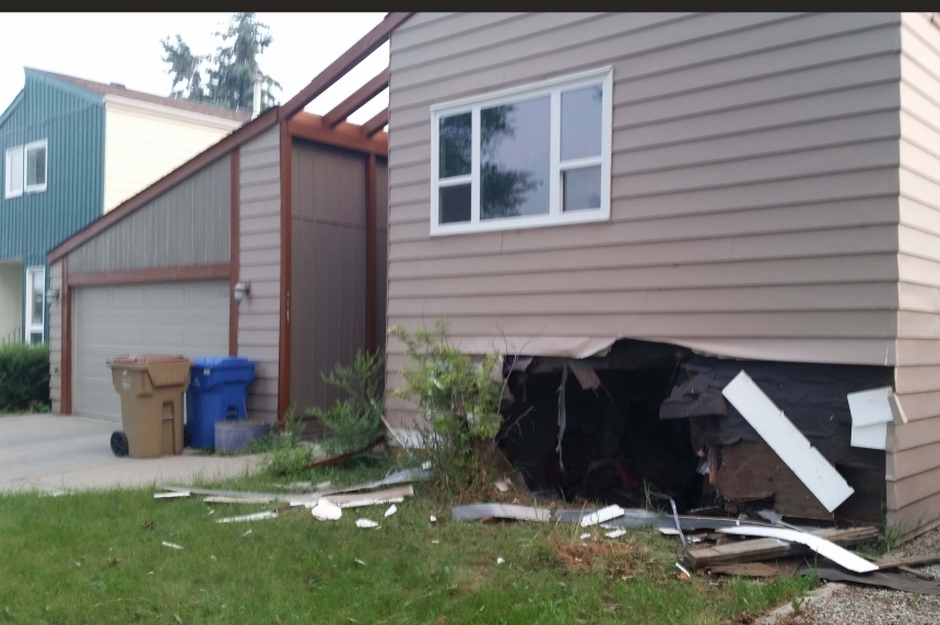 PHOTOS: Man charged after car crashes in Regina basement