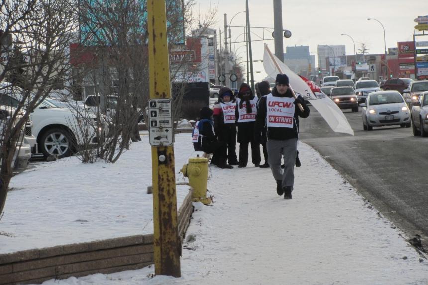 Some workers strike outside Regina hotel