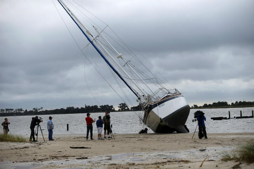 A weakening Nate brings burst of flooding, power outages
