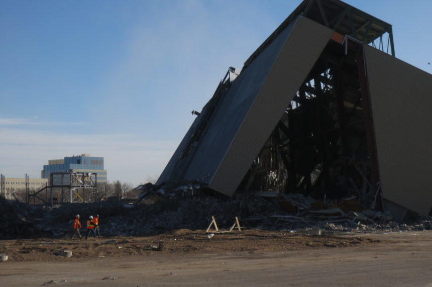 Fans watch grandstand at Taylor Field come down