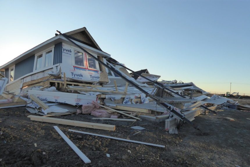 Townhome under construction crumbles in the wind