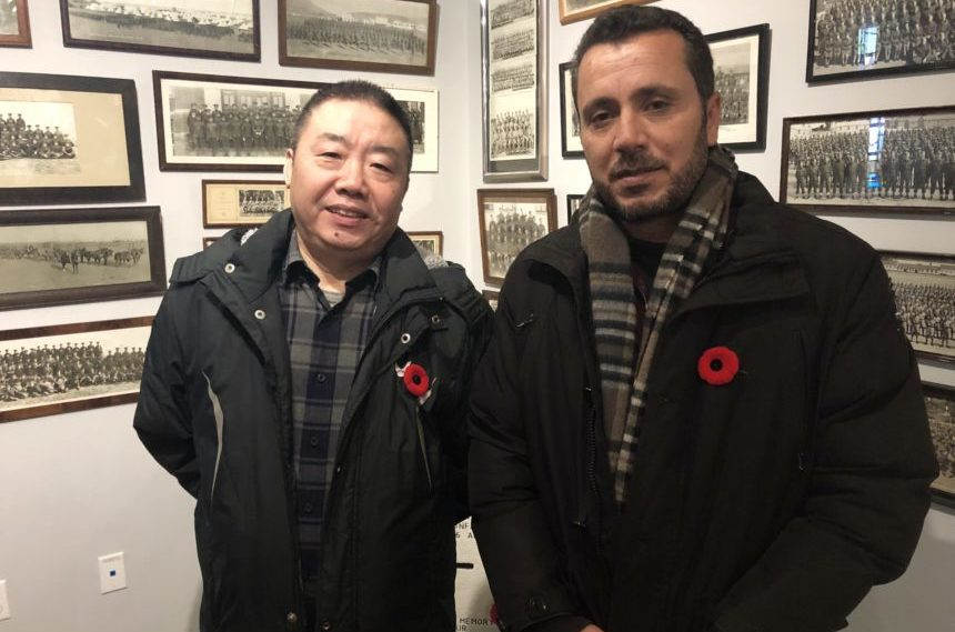 Newcomers learn about Remembrance Day at Regina Legion