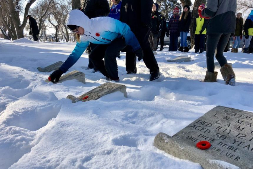 Regina students lay poppies on graves of war veterans