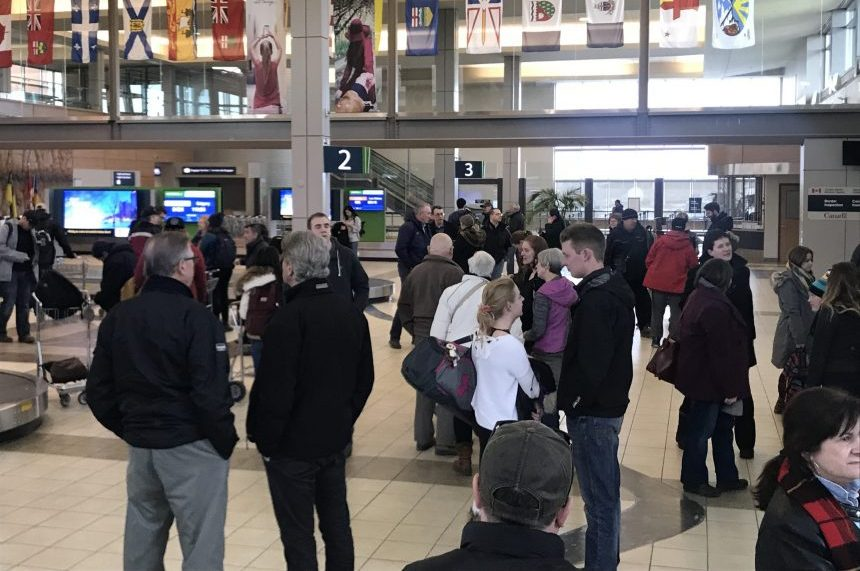Smiles, hugs and signs greet Christmas travellers at airport
