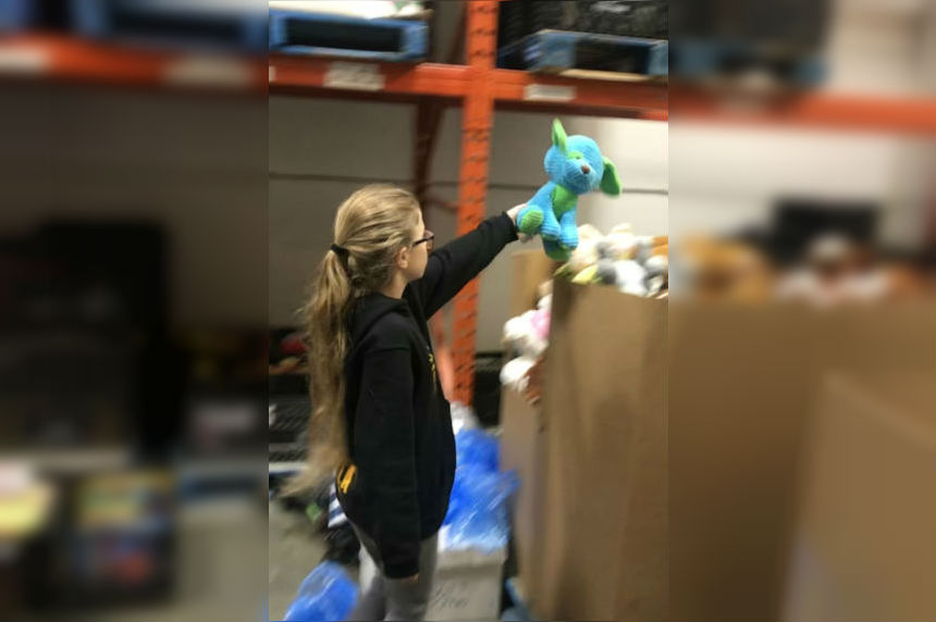 Students sort toys ahead of Santas Anonymous Wrap Day