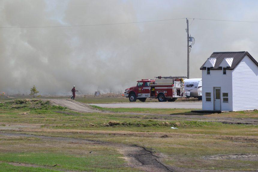 Fire crews battle grass fire near Regina Beach