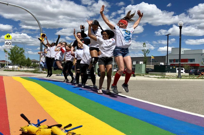 Elementary students paint Regina's first rainbow crosswalk